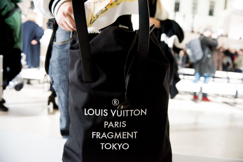 1c458c256a38 The large drawstring-like tote bag was born when Hiroshi Fujiwara bought  his own Louis Vuitton bag and added a felt cover to the handle for  protection
